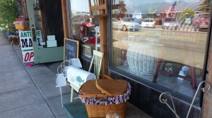 A festive July 4th scene outside the antique store which in the story is owned by Ivy and where the heroine and seventeen year old Maddie pick out vintage items for the cottage.